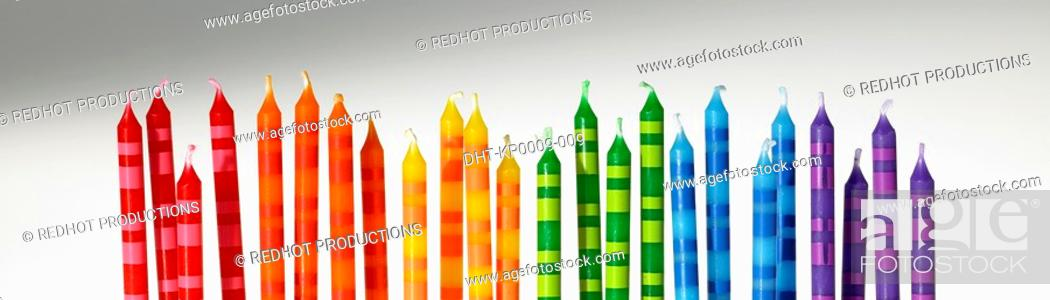 Stock Photo: Colourful Candles in a row.