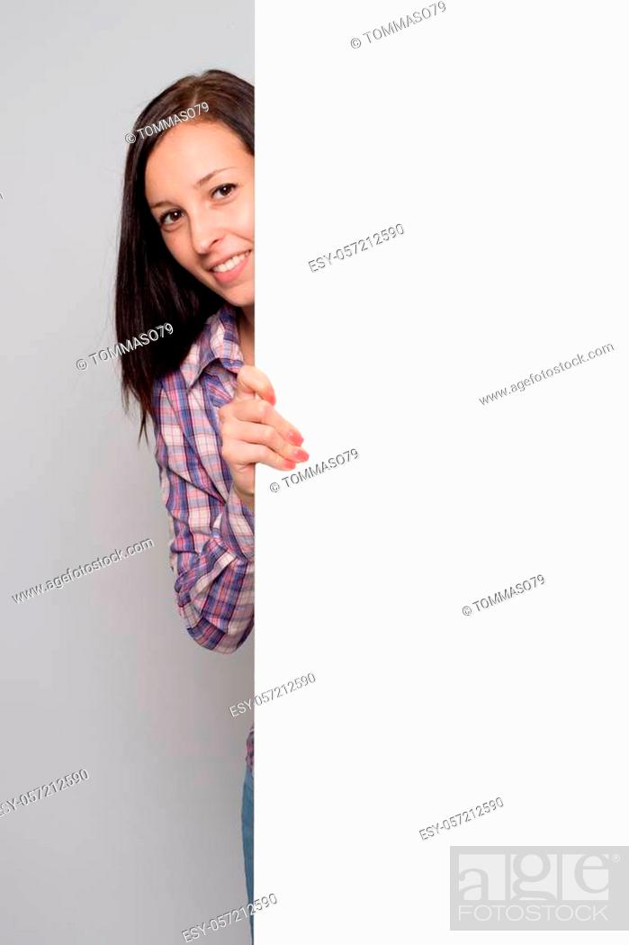 Stock Photo: Pretty young woman holding a blank banner.