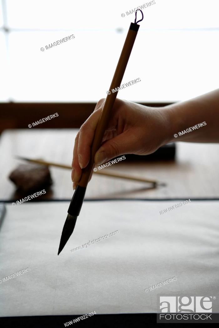 Stock Photo: Person painting on a canvas.