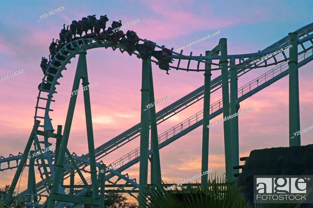 Stock Photo: Isla Magica (Magic Island) Theme Park, The Jaguar at sunset - roller coaster (and people upside), Seville, Region of Andalusia, Spain, Europe.