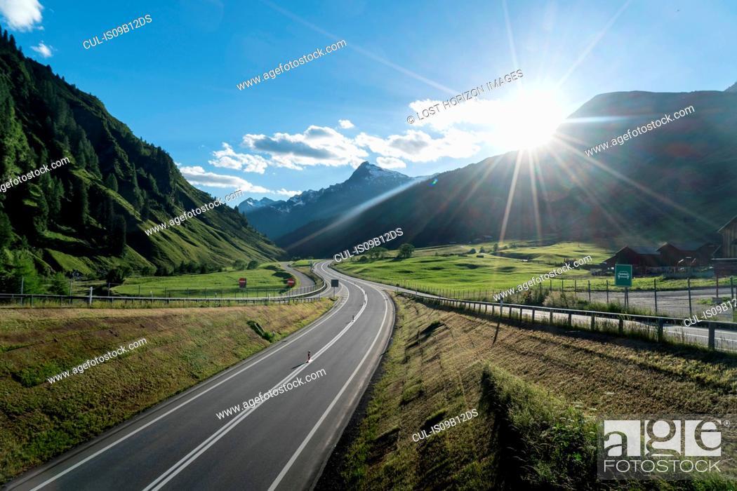 Stock Photo: Empty highway at sunset, Splugen, Canton Graubunden, Switzerland.