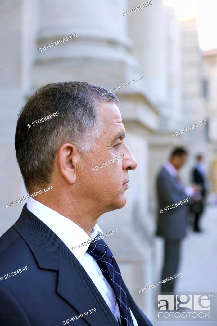 Stock Photo: Mature businessman, profile.