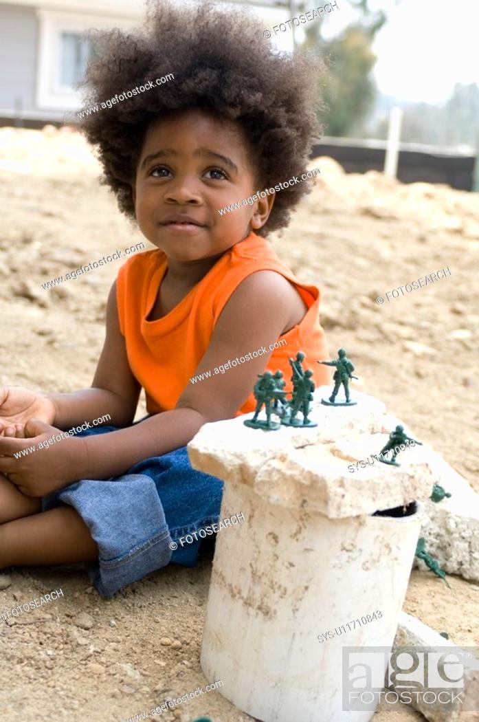 Stock Photo: Portrait of little boy playing outdoors.