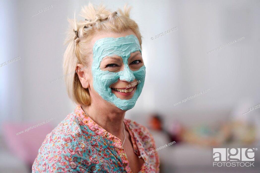 Stock Photo: Portrait of senior woman wearing facial mask.