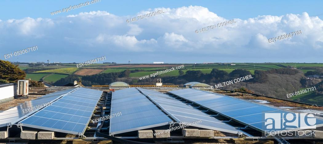Stock Photo: Solar panels on the roof of a building generating clean renewable electrical energy.