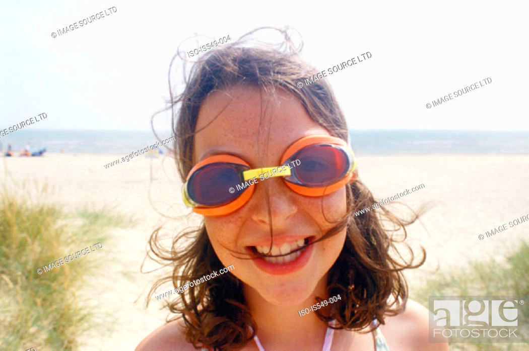 Stock Photo: Girl on the beach with swimming goggles.