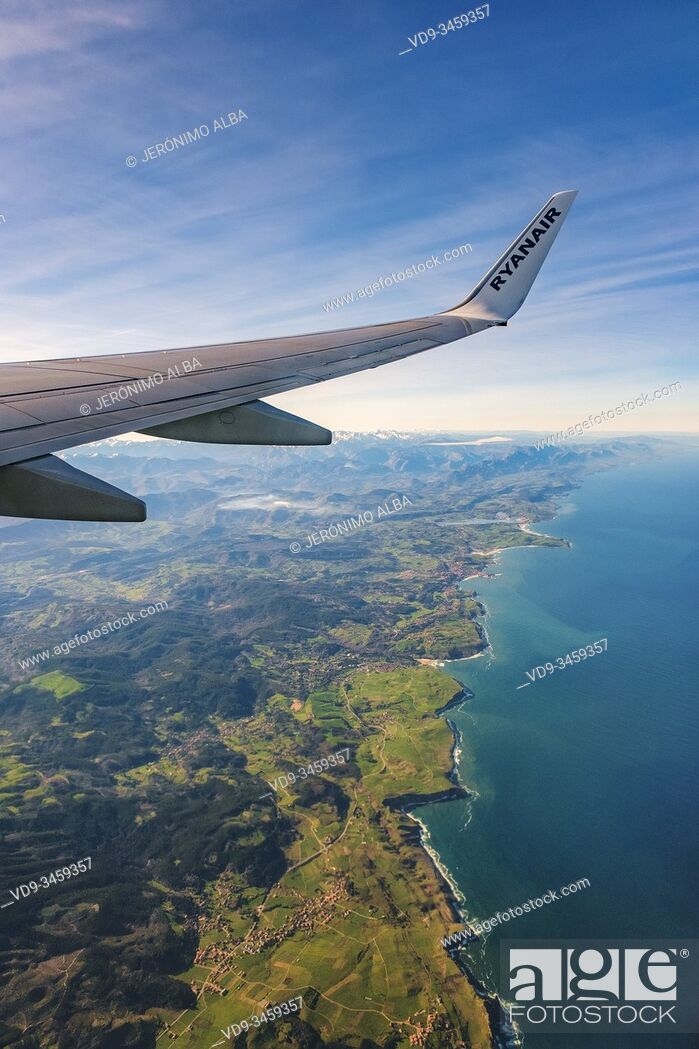 Stock Photo: Plane flying over sea coast of Cantabria, Cantabrian Sea. North Spain. Europe.