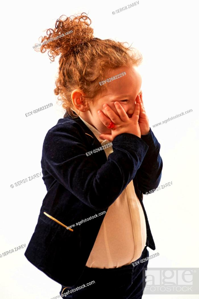 Stock Photo: Little girl in black suit standing and pouting.