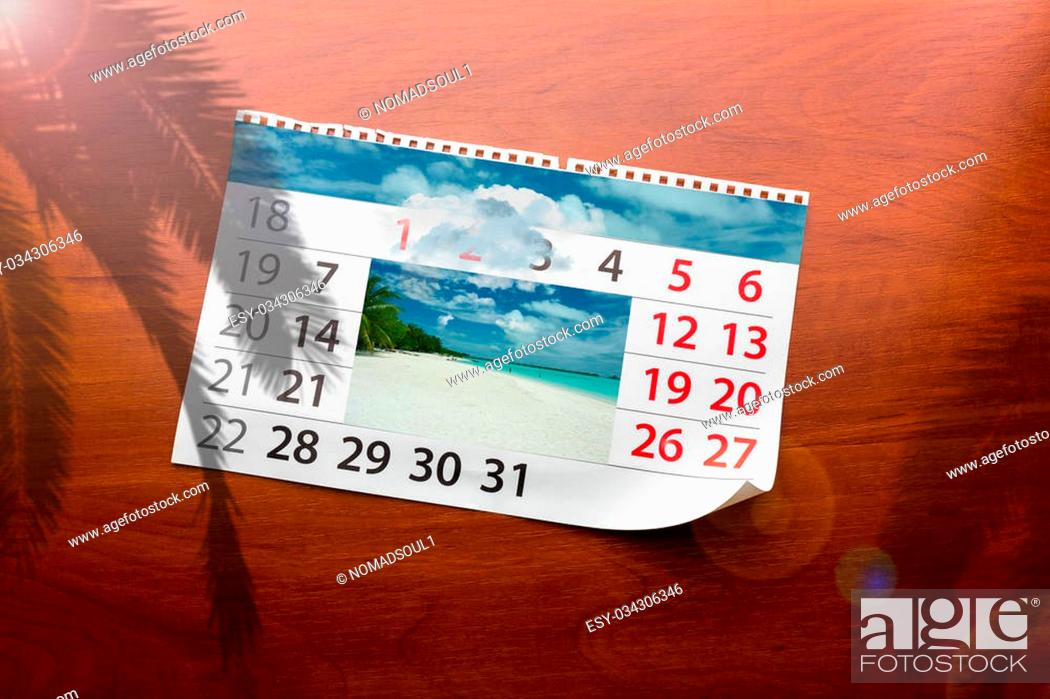 Stock Photo: Calendar with beautiful ocean landscape lays on the table.