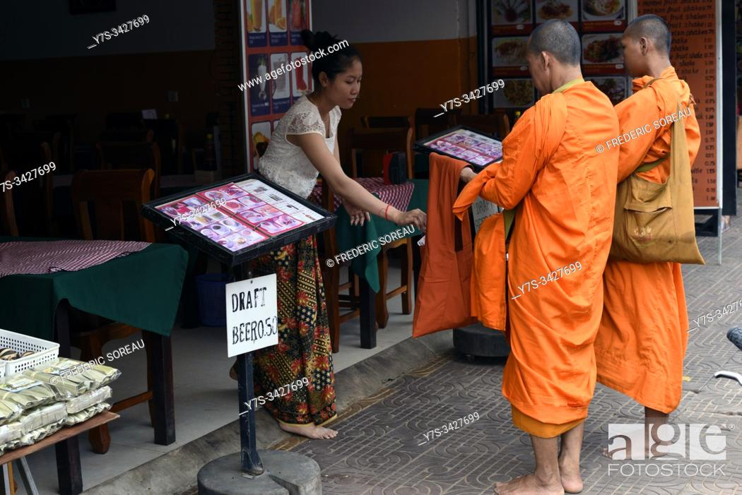 Stock Photo: Buddhist monks on their morning alms round, Siem Reap , Cambodia, South Esat Asia.