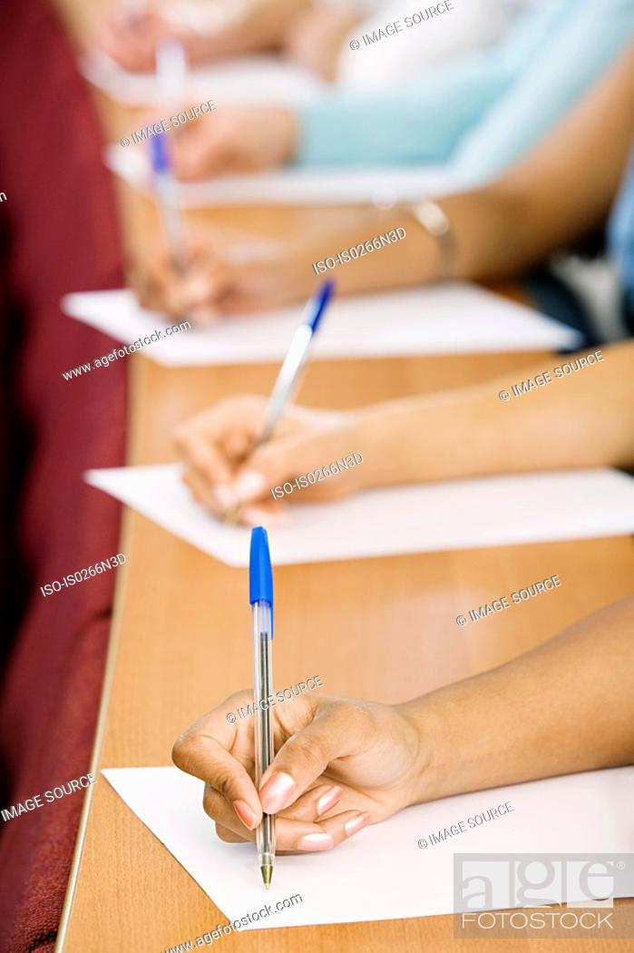 Stock Photo: Students taking notes.