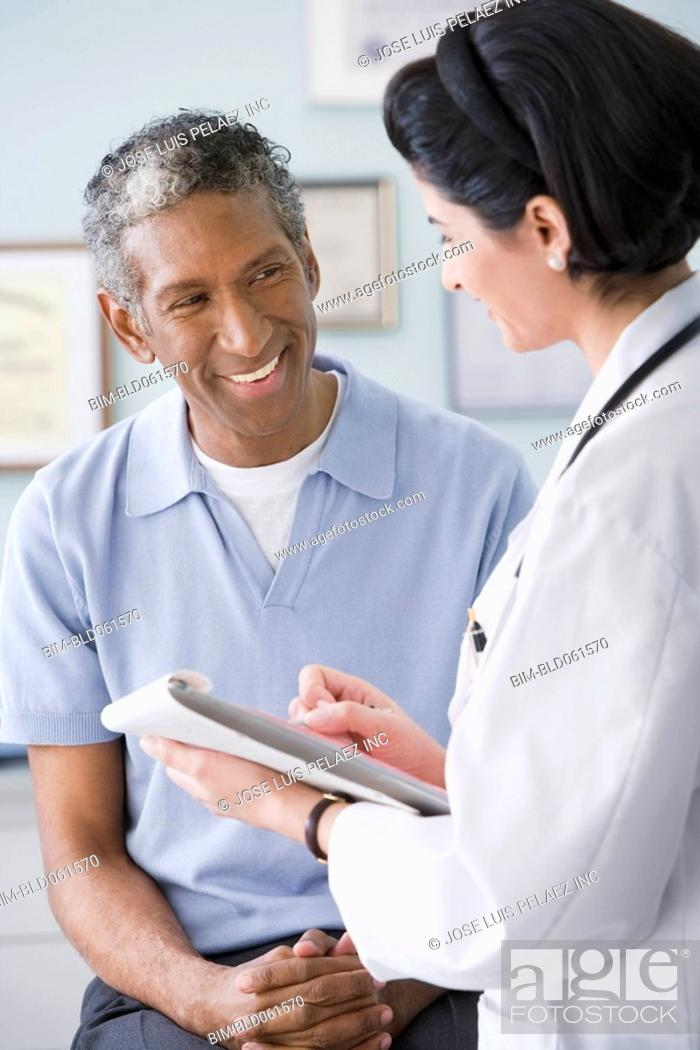 Stock Photo: Middle Eastern female doctor talking to patient.