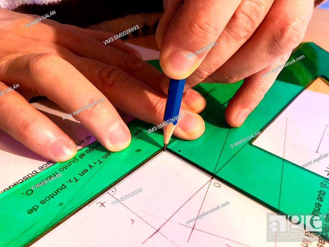 Stock Photo: Man using right triangles and pencil. Technical Drawing.
