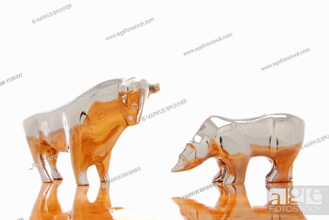 Stock Photo: Bull and bear figurines, symbolic image for the stock exchange.