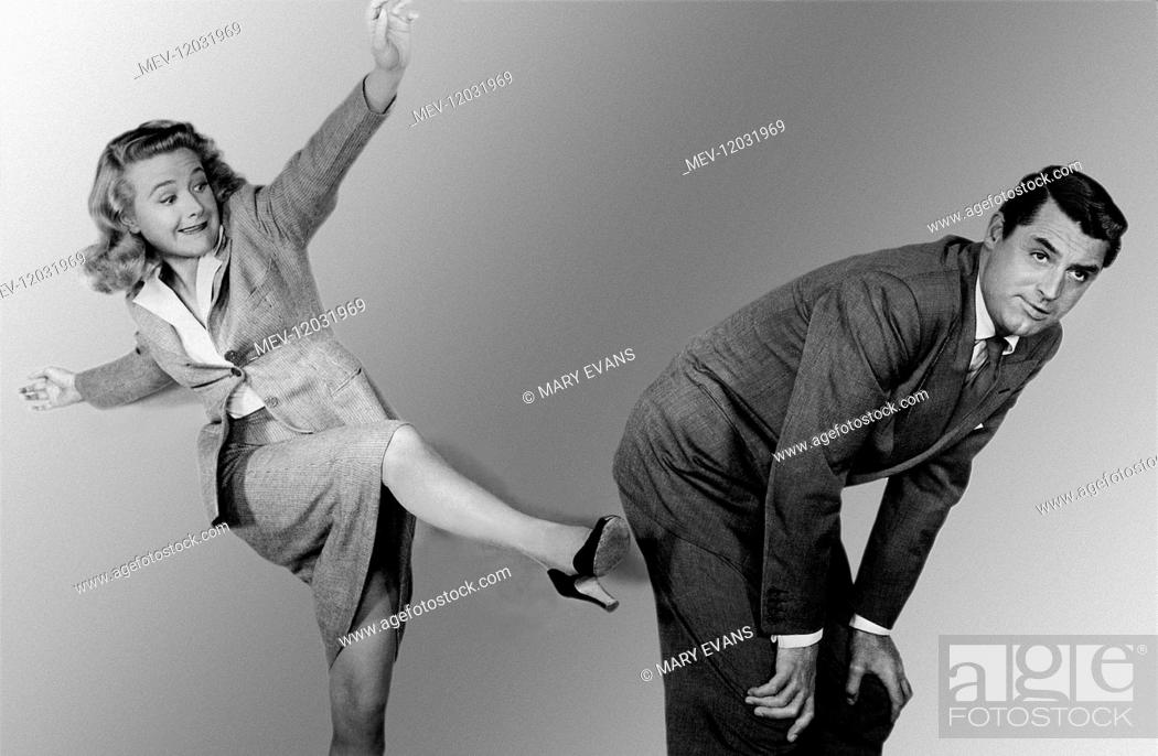 Stock Photo: Priscilla Lane & Cary Grant Characters: Elaine Harper & Mortimer Brewster Film: Arsenic And Old Lace (1949) Director: Frank Capra 01 March 1944.