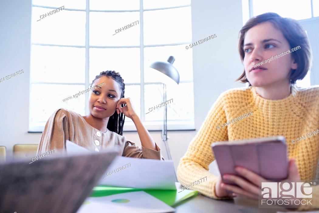 Stock Photo: Businesswomen working in office.