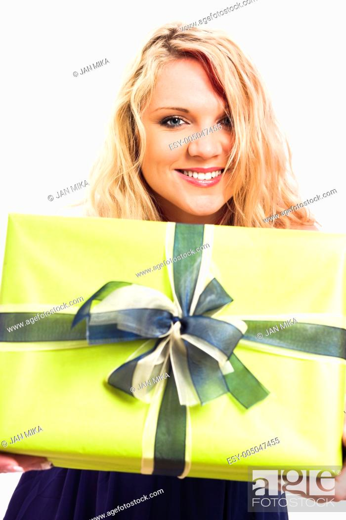 Stock Photo: Young blond happy woman holding green gift box, isolated on white background.