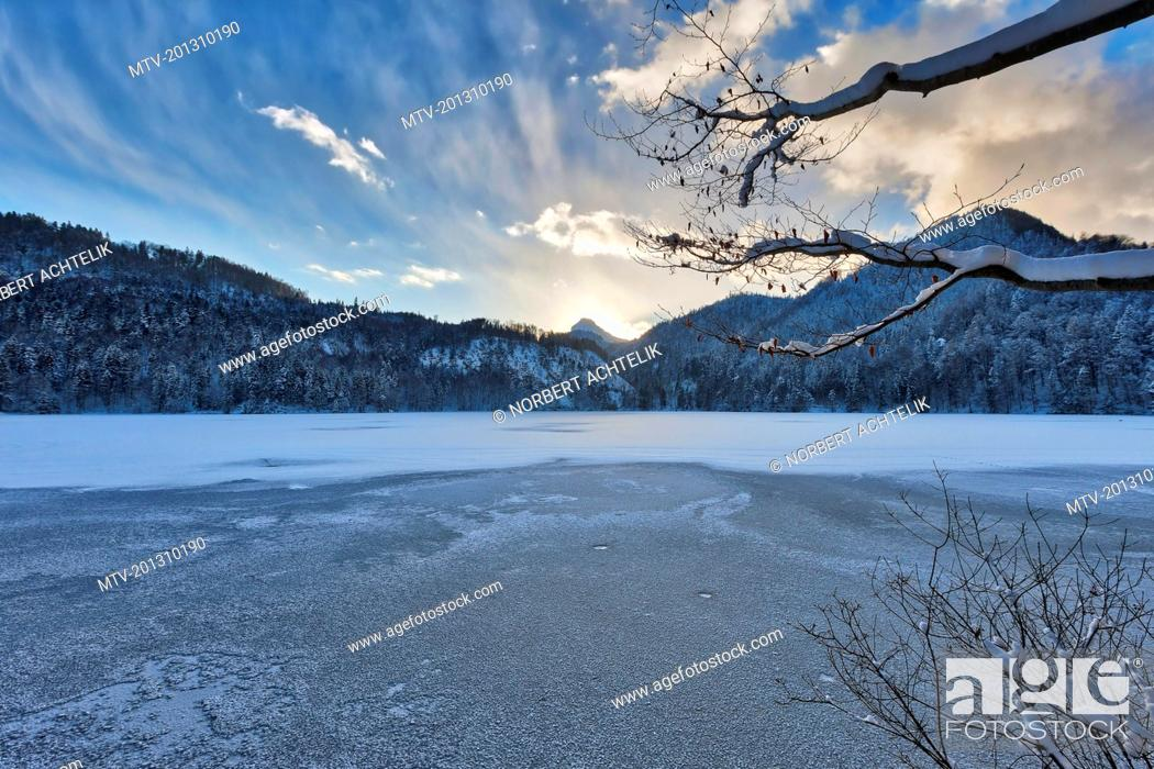 Stock Photo: Scenic view of frozen Hechtsee lake with snow covered trees and mountain.