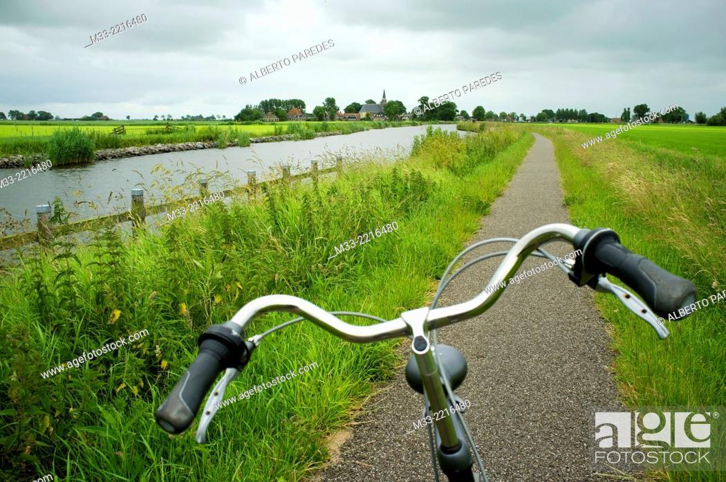 Stock Photo: Bike route near Bolsward, Friesland province (Fryslan), Netherlands.