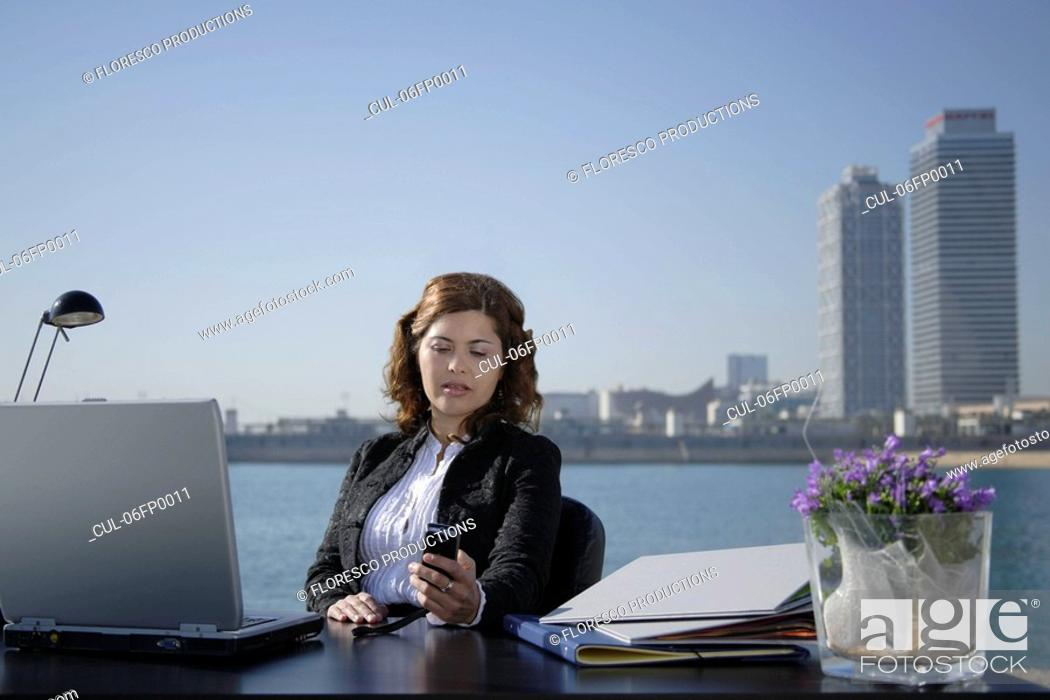 Stock Photo: Business woman in outdoor office.