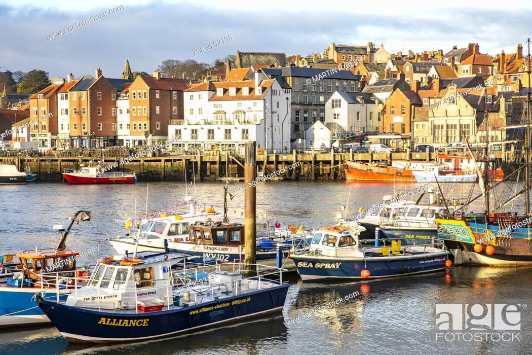 Stock Photo: Fishing boats and charter boats in Whitby Harbour, North Yorkshire.