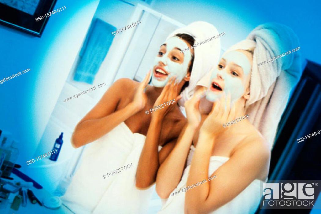 Stock Photo: Two young women wearing facial masks.