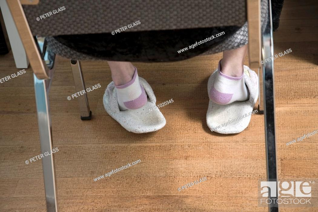 Stock Photo: Close-up of sandals on a woman's feet.