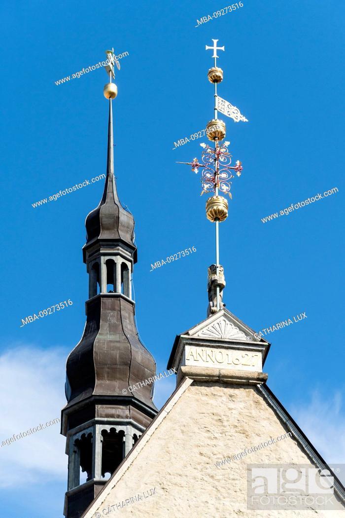 Stock Photo: Estonia, Tallinn, city hall with ornate weathervanes.