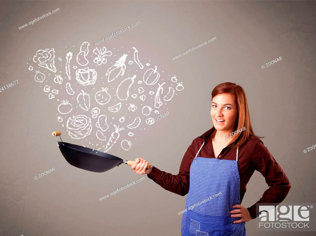 Stock Photo: Woman cooking vegetables.