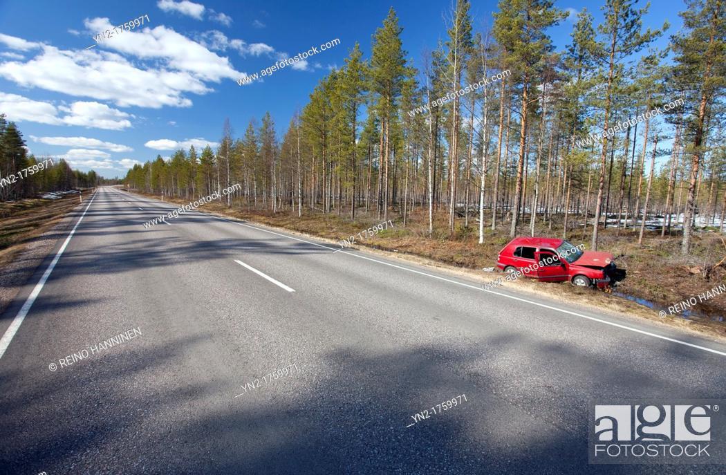 Stock Photo: Crashed Volkswagen Golf at roadside ditch  Location Peurasuo Ahokylä Finland Scandinavia Europe.