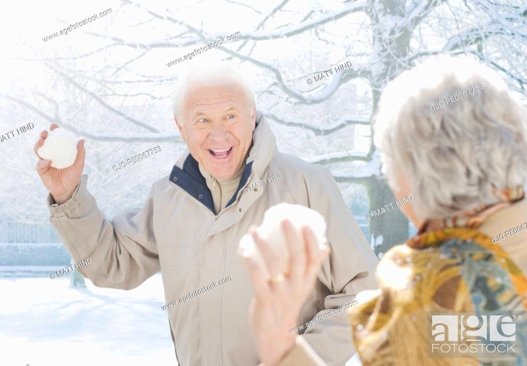 Stock Photo: Couple throwing snowballs.