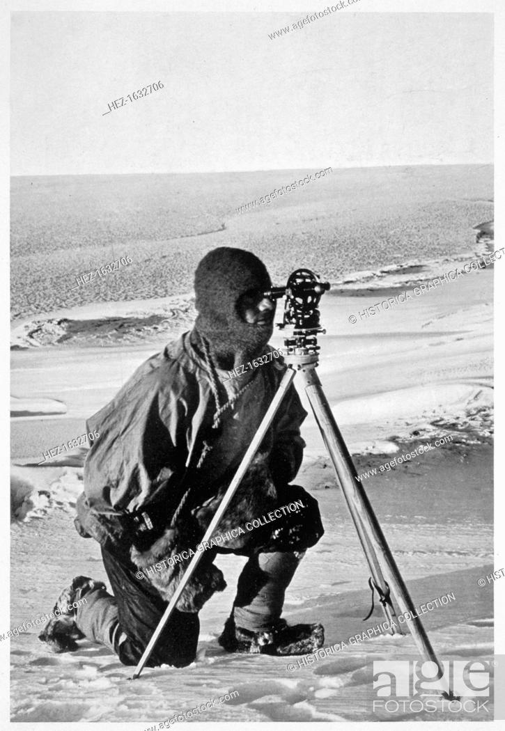 Stock Photo: Lieutenant Evans surveying in the Antarctic, 1911-1912. Evans using the 4 inch theodolite used to locate the South Pole on Captain Scott's Antarctic expedition.