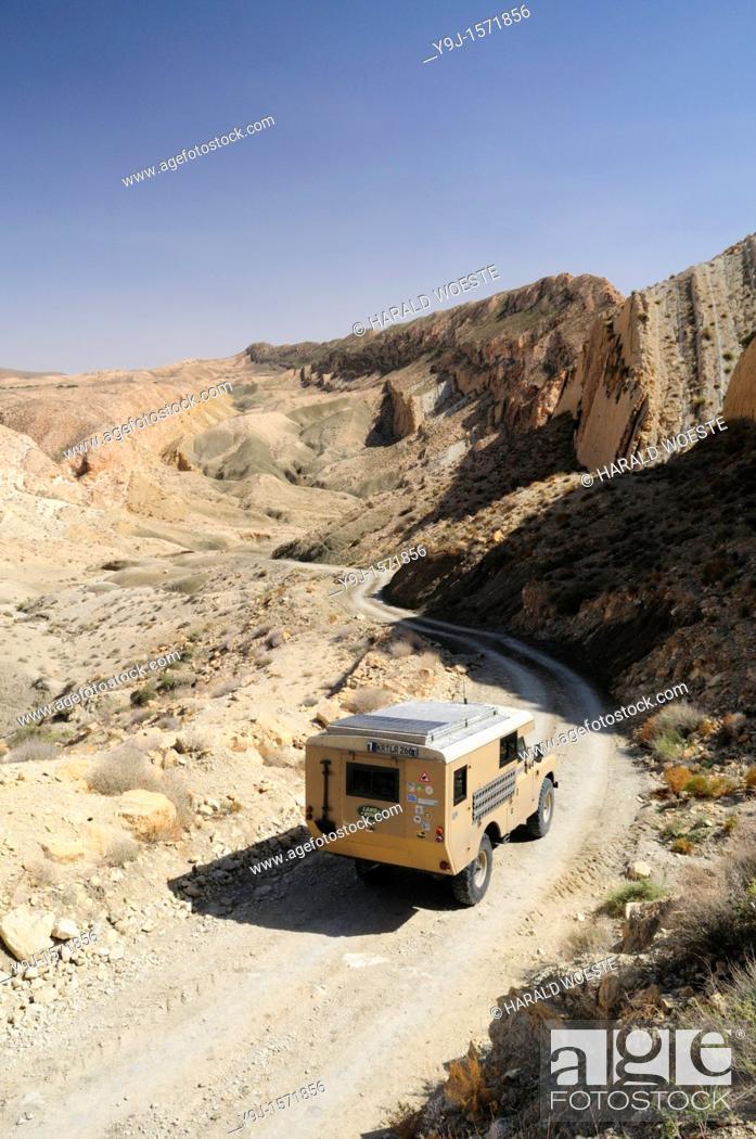 Stock Photo: Africa, Tunisia, nr  Saket  Land Rover camper van descending into the famous narrow gorge near Saket.