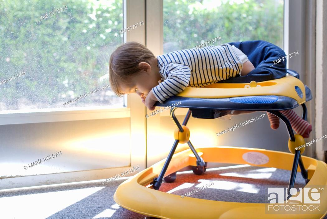 Stock Photo: Baby, 10 Months, Walker, Leaning, Mischievous, Risk, Indoors, Door- window, sunlight, garden, Playful.