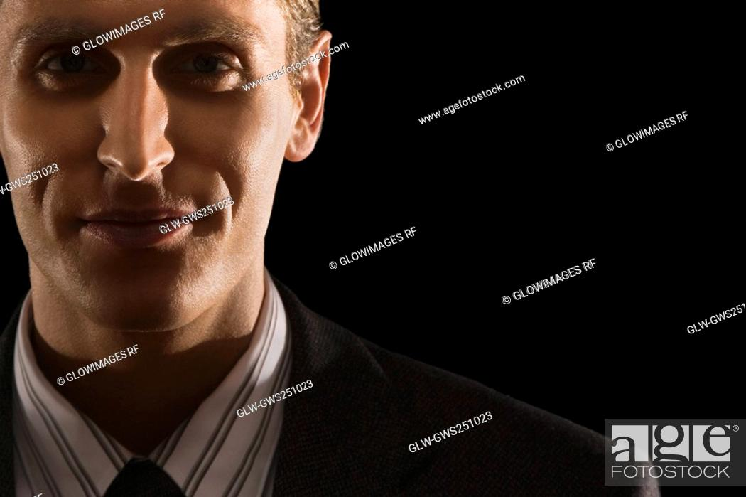 Stock Photo: Close-up of a businessman smiling.