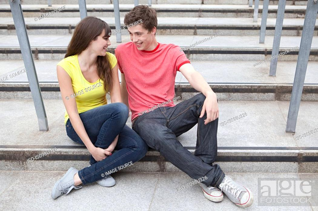 Stock Photo: Young couple sitting on steps.