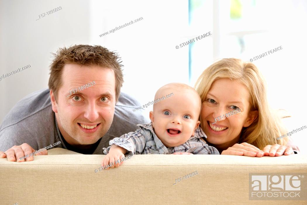 Stock Photo: Parents with their six month year old baby.