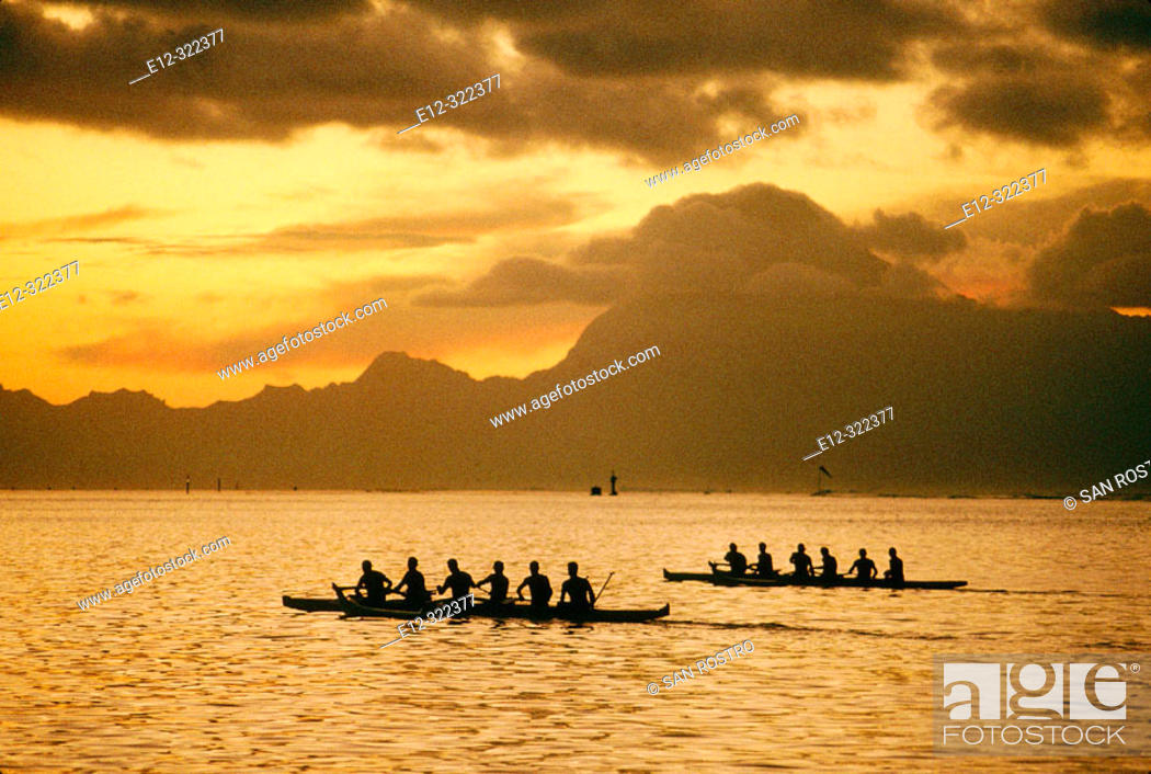 Stock Photo: Training for the annual rowing contest, Moorea island in background. Papeete, Tahiti, French Polynesia.