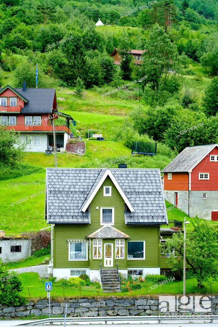 Stock Photo: Green house typical of the architecural style around Olden fjord in Norway.