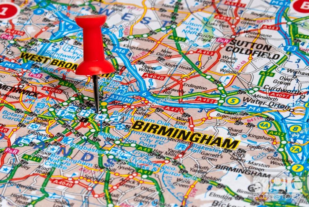Stock Photo: red map pin in road map pointing to city of Birmingham.