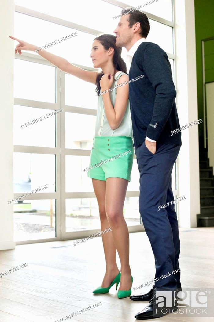 Stock Photo: Couple looking for a new house.