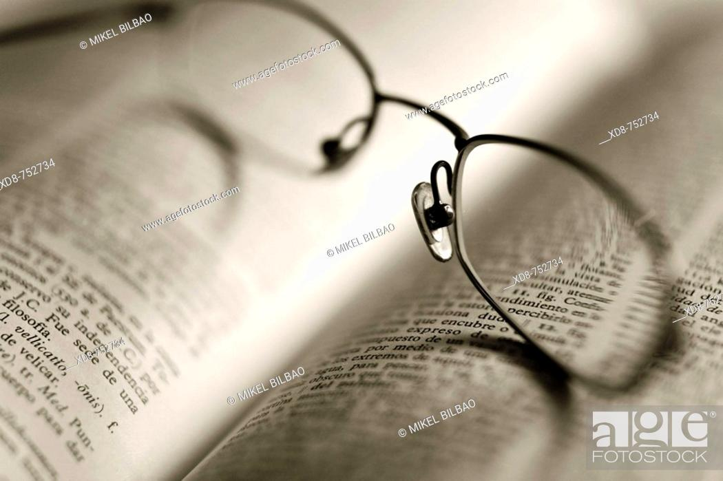 Stock Photo: book and glasses detail.