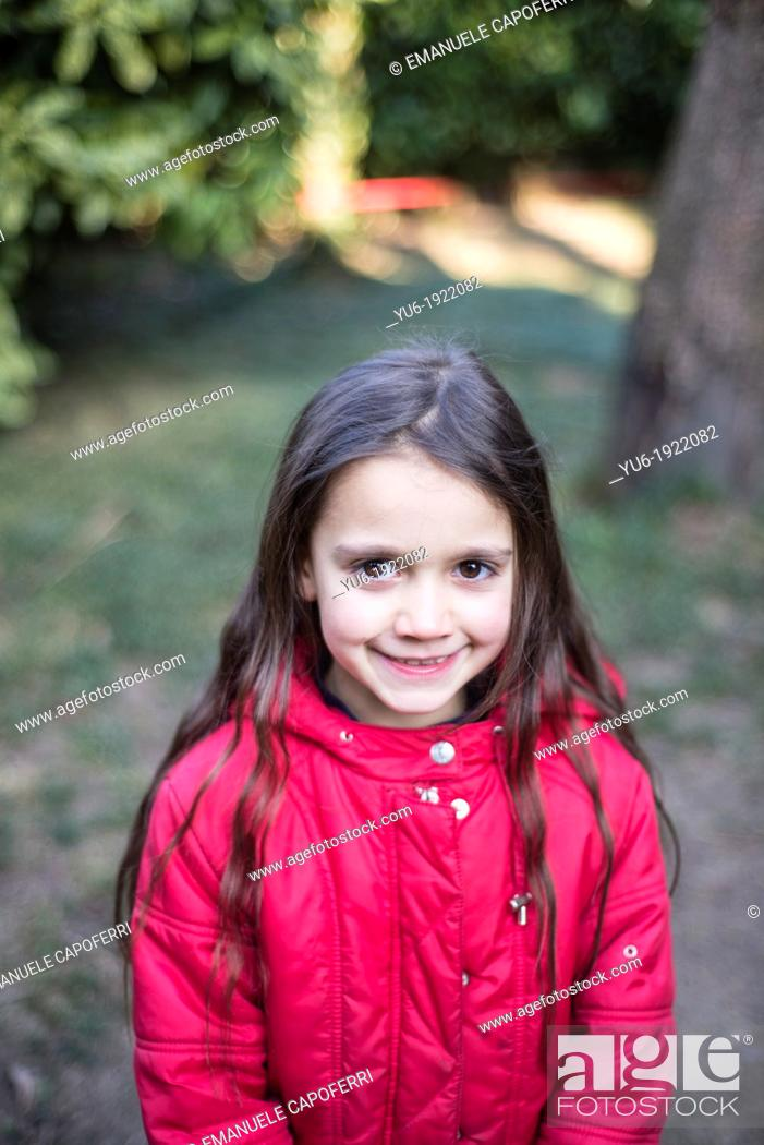 Stock Photo: Portrait of 6 year old girl smiling.
