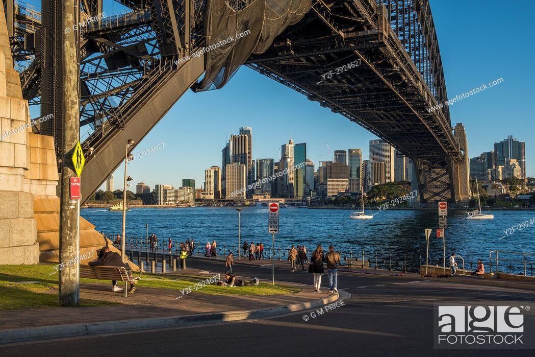 Stock Photo: Sunny Sunday afternoon below Sydney Harbour Bridge.