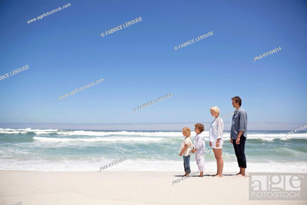 Stock Photo: Couple standing on the beach.