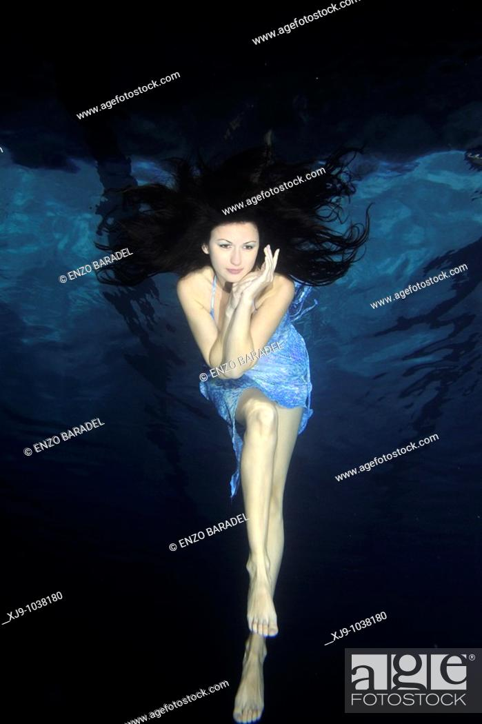 Stock Photo: Girl swimming under the water fashion.