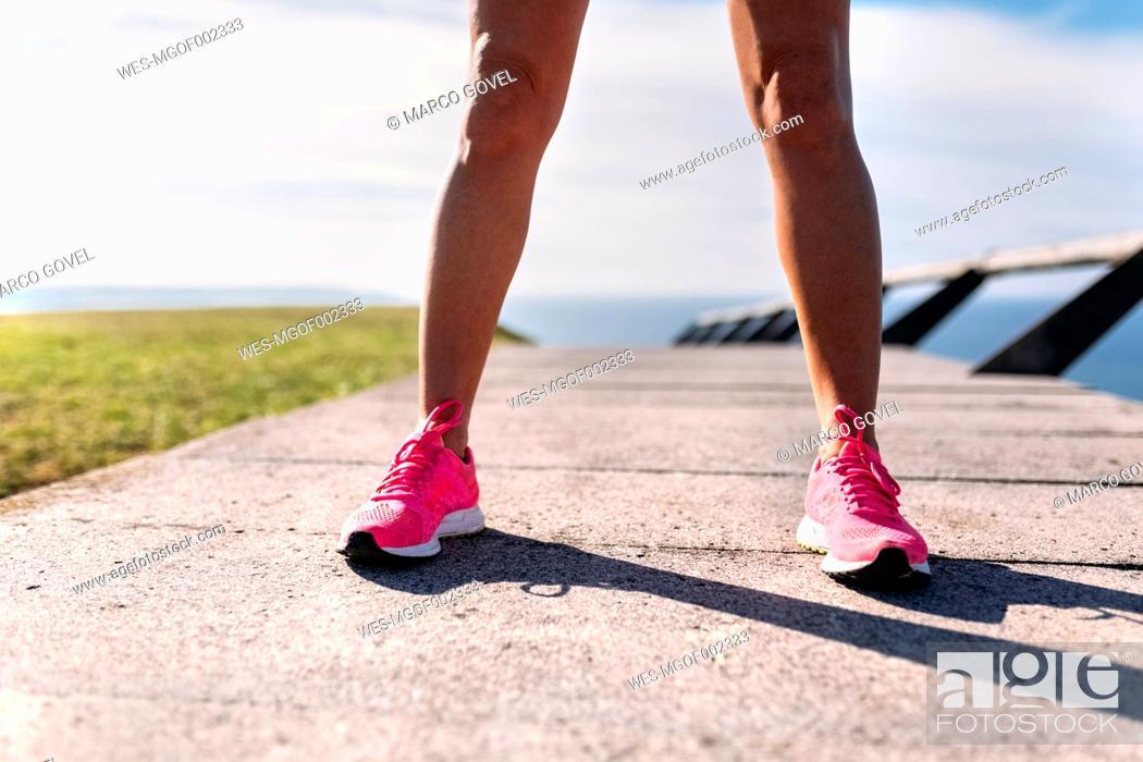 Stock Photo: Legs of female runner.