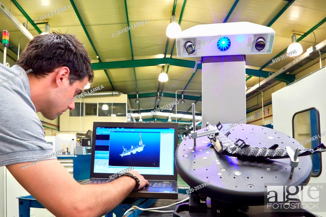 Stock Photo: Rexcan CS +. White Light System. Technician inspecting production piece in 3D measurement system without contact. Innovative Metrology applied.