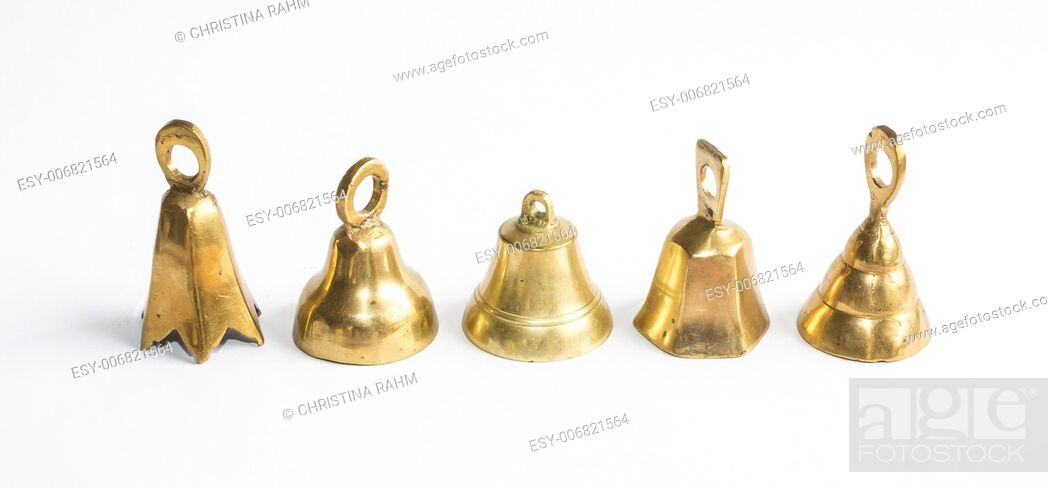 Stock Photo: Five brass bells on white background.