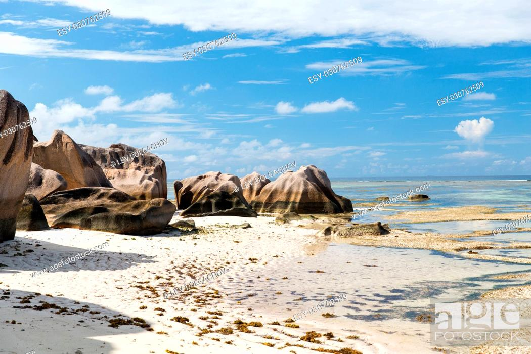 Stock Photo: travel, landscape and nature concept - rocks on seychelles island beach in indian ocean.
